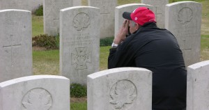A visitor from British Columbia, Chris Hill takes a picture at Jimmy's graveside, Adanac Military Cemetery, Miraumont, Somme, France, 2009. (P. Ferguson)