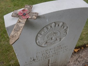 Poppy cross covered with mud at the graveside of Sgt. E.E. Patchman MM, Australian Field Artillery, Ypres Reservoir Cemetery. (P. Ferguson iimage 2016)