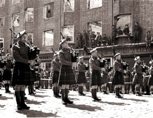 "Pipers of the 51st Highland Division, 1945. In 1940 the 51st (HD) ""was isolated, abandoned, and forced to surrender"". (51st HD website)."
