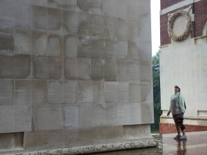 A new visitor to Thiepval reads their names. From floor to skyward and around the next corner, name upon name, life upon life. (P. Ferguson image, August 2018)