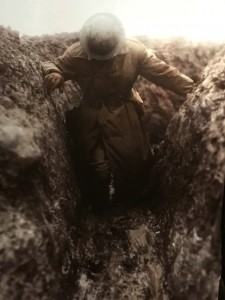 A Great War soldier making his way through the wet and person clinging mud of the trenches. Imperial War Museum trench scene. (P. Ferguson image, August 2018)