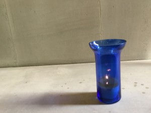 Candlelight within a blue vase at the Guards Chapel, London. (P. Ferguson image, August 2018)