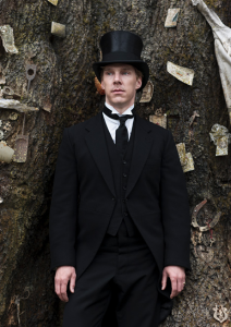 Benedict Cumberbatch as Christopher Tietjens stands before the ancient cedar, the Groby Tree. (Parade's End Screenshot).